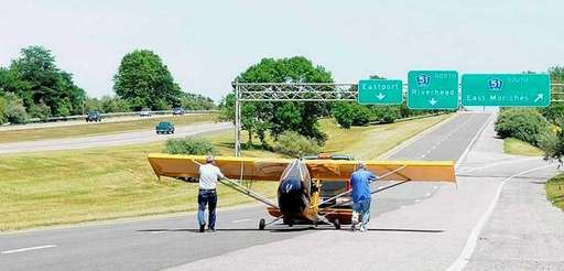 Pilot Frank Fierro, right, removes his single-engine Ultralight