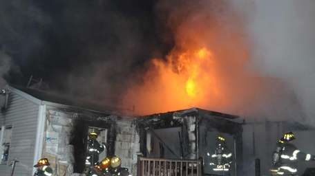 Two firefighters were injured and three pets died