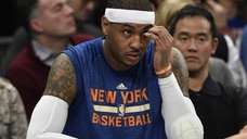 New York Knicks forward Carmelo Anthony looks on