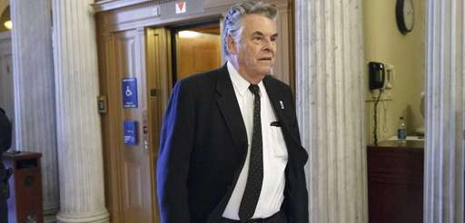 Rep. Peter King, R-N.Y., arrives for votes on