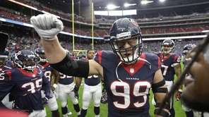 Houston Texans defensive end J.J. Watt (99) cheers