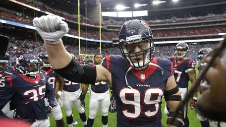 Houston Texans defensive end J.J. Watt (99) cheers