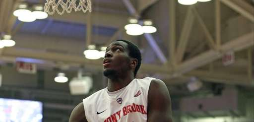 Stony Brook's Jameel Warney #20 goes up for