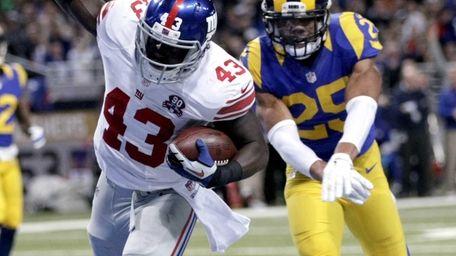 New York Giants running back Orleans Darkwa, left,