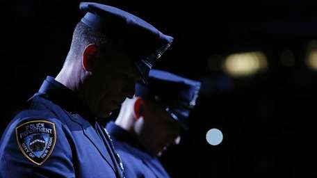NYPD Officers Mark Cava and Jason Muller of