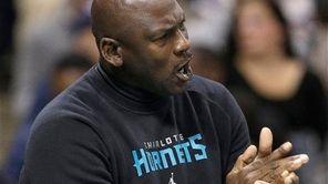 Charlotte Hornets owner Michael Jordan cheers on his
