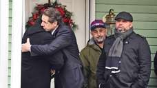 Gov. Andrew M. Cuomo, second from left, visits