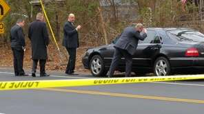 Suffolk County police investigators at scene of a