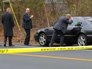 Suffolk County police investigators at scene of a