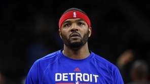 The Detroit Pistons' Josh Smith warms up before