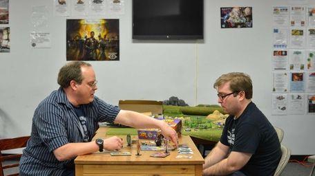 Left, Dave VanderWerf, owner of Game Master Games