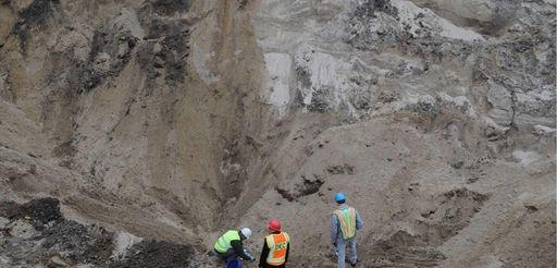 Contractors are seen working at Veterans Way in