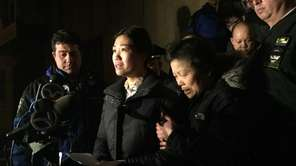 Pei Xia Chen, center, wife of killed NYPD