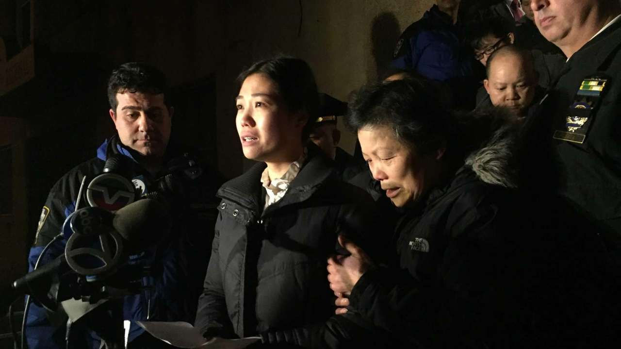 Pei Xia Chen, center, wife of slain NYPD