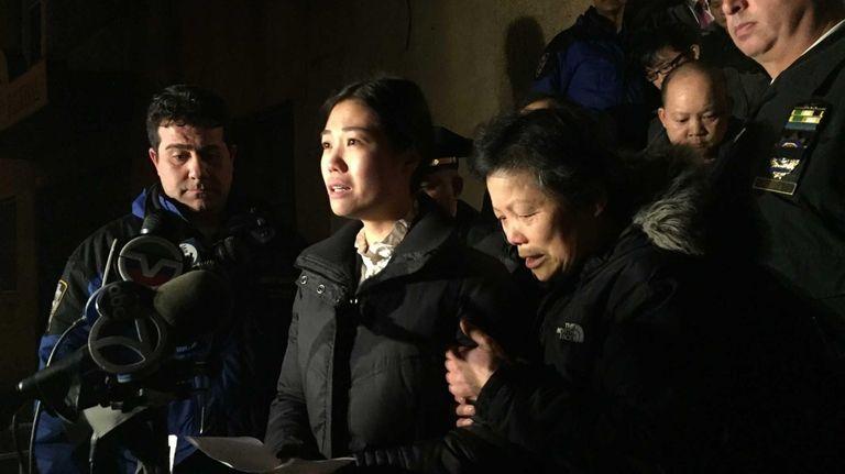 Pei Xia Chen, center, wife of slain NYPD
