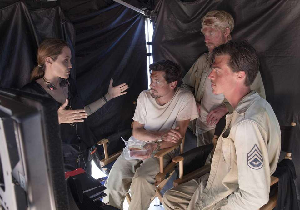 Angelina Jolie directs actors, from left, Jack O'Connell,