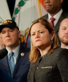 City Council Speaker Melissa Mark-Viverito, surrounded by City