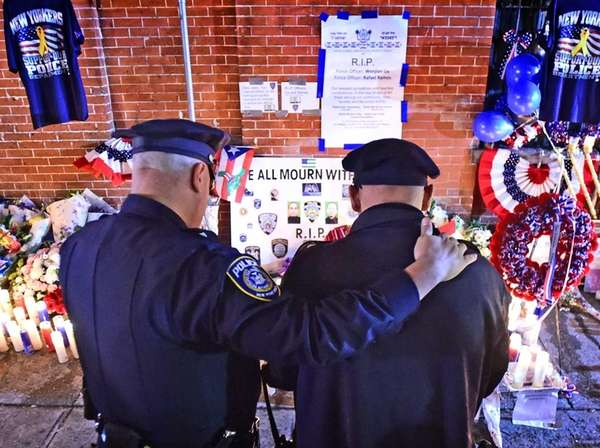 Police officers gather to mourn the loss of
