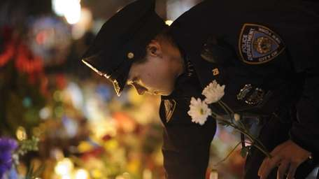 New York City police officers visit the makeshift