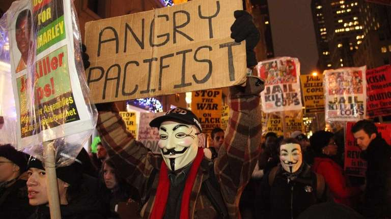 Protesters march on Fifth Avenue in Manhattan on