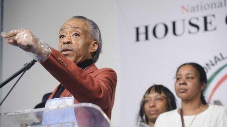 Civil Rights activist Reverend Al Sharpton, left, speaks