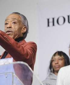 Civil Rights activist Reverend Al Sharpton, left, speaks