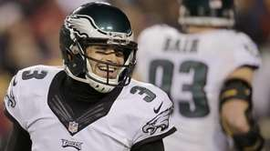 Philadelphia Eagles quarterback Mark Sanchez smiles after wide