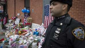 A New York Police Department officer stands guard