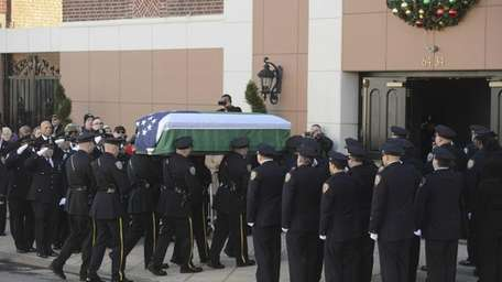 The coffin of slain Officer Rafael Ramos is