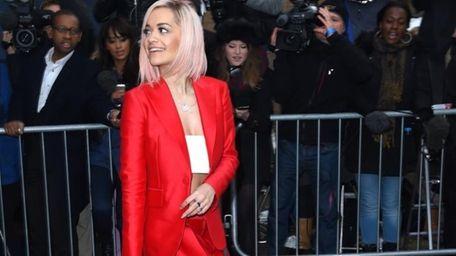 Singer Rita Ora leaves a music studio after