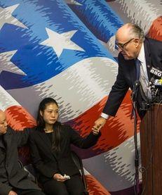 Former Mayor Rudy Giuliani comforts Pei Xia Chen,