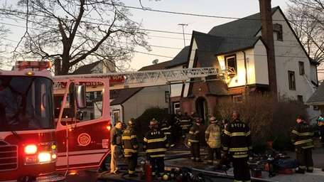 Crews respond to a house fire on Spruce