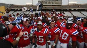 The Louisiana Tech Bulldogs celebrate their 35-18 win