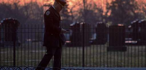 A police officer arrives for the funeral service