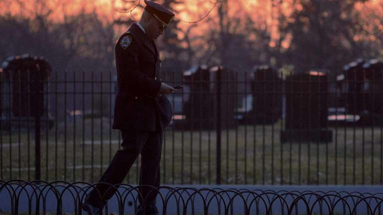 A police officer arrives for the funeral for