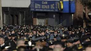 NYPD officers, joined by law enforcement and first