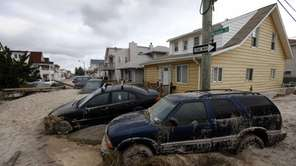Cars lifted by floodwater from superstorm Sandy are