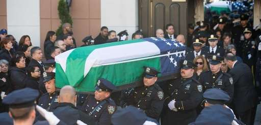 The casket carrying NYPD officer Rafael Ramos is