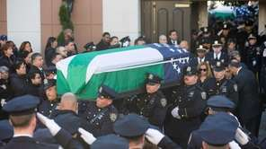 The coffin carrying NYPD officer Rafael Ramos is