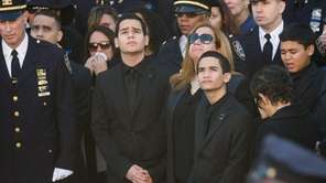 Family members Jaden Ramos, right, Justin Ramos and