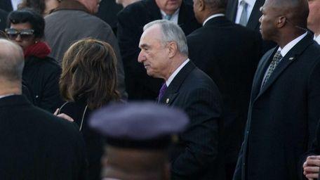 New York City Police Commissioner Bill Bratton enters