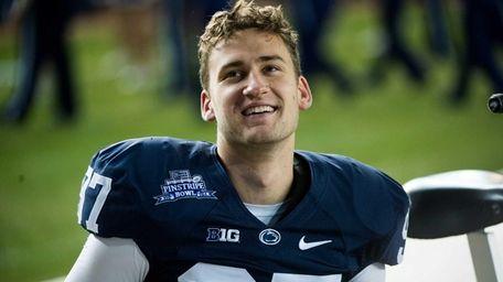 Penn State Nittany Lions placekicker Sam Ficken looks