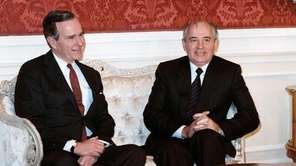 Soviet leader Mikhail Gorbachev (R) meets with US