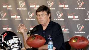 Houston Texans general manager Charley Casserly speaks to