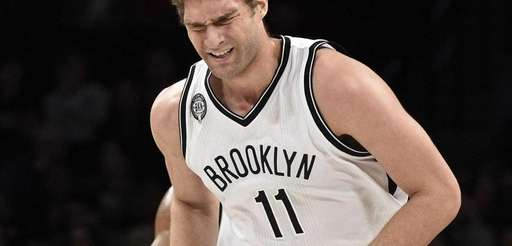 Brooklyn Nets center Brook Lopez reacts after missing