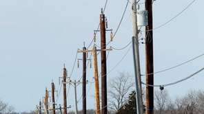 Newly erected utility poles along Old Stone Highway