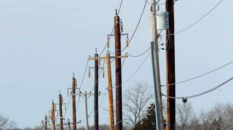 Newly erected utility poles line Old Stone Highway
