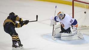 Buffalo Sabres center Tyler Ennis, left, scores on