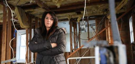 Patricia Giovinco in her flood-ruined home on Michigan