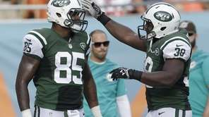 New York Jets fullback John Conner (38) congratulates